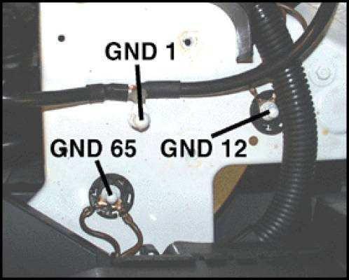 d23e87ff-8d47-478a-b026-0ce7d660cfbd_2002 Jetta GLI gounds under battery tray.jpg